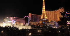Las Vegas strip night neon Bellagio water fountain dolly Stock Footage