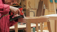 Man Using a Staple Gun, Medium Shot Stock Footage