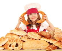 Happy little girl cook with breads and rolls Stock Photos