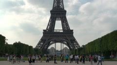 Underneath the Eiffel Tower with lot of tourists Stock Footage