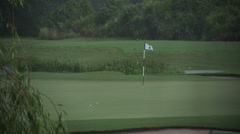 Heavy Rain Storm at Golf Course with Flag Blowing Stock Footage