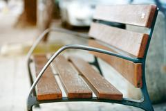 Stock Photo of Antique metal bench on the park. vintage color toned image