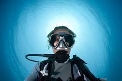 Underwater portrait of a woman suba diving. Stock Photos