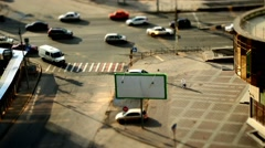 Busy city street with moving cars and pedestrians. Tilt shift. Time lapse Stock Footage