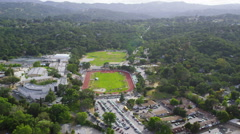 Aerial view of California college athletics track Stock Footage