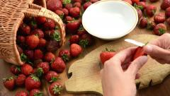 Cleaning strawberries in small bowl Stock Footage