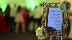 Beautiful text at wedding with people dancing in the background Stock Footage