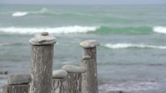 Mooring poles with sea in the background,Arniston,South Africa Stock Footage