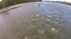 Fishermen wading in the river as the water flows by Stock Footage