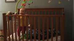 Baby Jumping in Crib Stock Footage