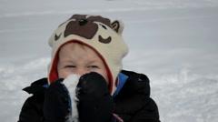 Boy hams it up in winter Stock Footage