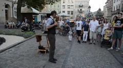 The conjurer pulls together a neck with ropes. Lviv, Ukraine. Stock Footage