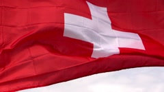 Swiss flag in the wind in sunlight Stock Footage