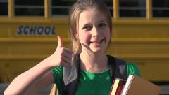 School girl thumbs up - slow motion - stock footage