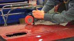 Sanding car door in bodyshop Stock Footage