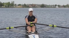 Womens single scull rowing Stock Footage