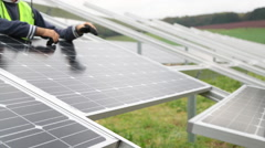 Engineers Working On Solar Panels. Installing solar panels. - stock footage