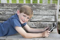 A young boy outdoors. Stock Photos