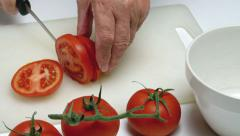 Male hands slicing fresh tomatoes, red, white, green. Food Stock Footage