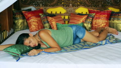 Woman resting and sleeping on oriental and comfortable bed Stock Footage