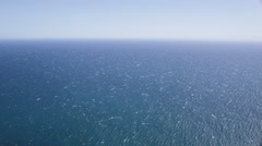 Aerial helicopter view of perfect blue Ocean Stock Footage