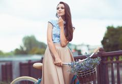 young beautiful, elegantly dressed woman, summer and lifestyle - stock photo