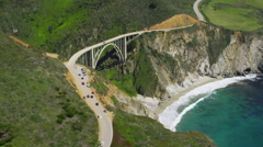 Aerial view of bridge spanning Californian coast Stock Footage