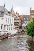 Canals and brick houses of bruges in belgium flanders Stock Photos