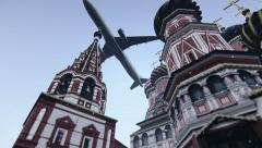 Plane passing at The Cathedral of Vasily the Blessed in Moscow, Russia. Stock Footage