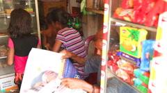 MIRISSA, SRI LANKA - MARCH 2014: Family in local convenience store. - stock footage