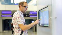 Young man using touch screen info in the station HD Stock Footage