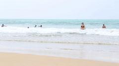 Stock Video Footage of People enjoying the ocean in Mirissa.