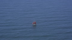 Aerial view of red sail boat Stock Footage