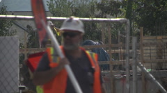 Construction workers and supervisor discussion on job site Stock Footage