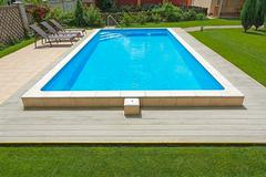 Swimming pool in the yard of a private home. Stock Photos