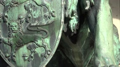 4k Close up tilt view lion sculpture with shield Stock Footage