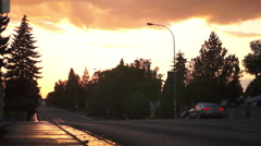 Cars Driving in Wet Sunset Stock Footage