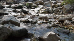 Babbling Brook flows through a rocky terrain Stock Footage