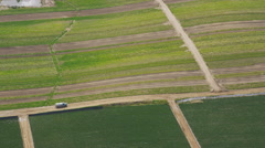 Aerial shot of tractor on agricultural farm land California - stock footage