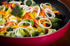 Frying pan with vegetables Stock Photos