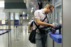 Man buying ticket at ticket office at train station NTSC Stock Footage