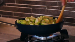 Frying pan on fire, vegetable marrows mix in a frying pan Stock Footage