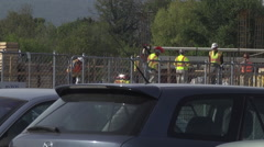 Construction workers and supervisor on job site wide shot Stock Footage