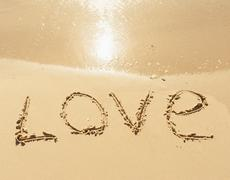 Stock Photo of word love on the sand