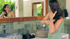 Woman brushing and tie hair in the bathroom - stock footage