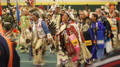 Grand entry goes by in proud fashion at pow wow Stock Footage