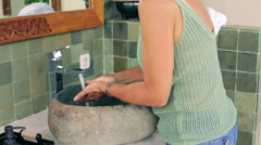 Woman using soap and cleaning her hands in the bahtroom Stock Footage