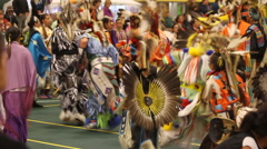 Pow wow grand entry looking at backs of dancers Stock Footage