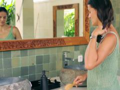 Woman brushing and tie hair in the bathroom Stock Footage