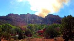 Forest Fire Smoke Billowing From Behind Ridge- Sedona AZ Stock Footage